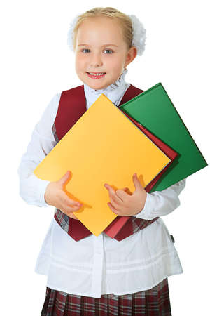 Portrait of a cute schoolgirl with books. Isolated over white background. photo