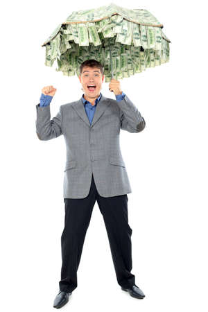 Business concept: businessman holding an umbrellar of money. Isolated over white.  photo