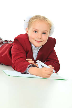 Portrait of a cute schoolgirl with pen and workbook. Isolated over white background. photo