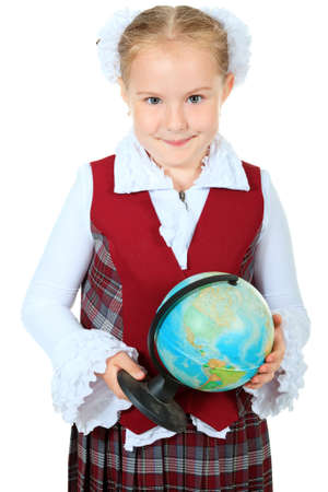 schoolgirl uniform: Portrait of a cute schoolgirl with a globe. Isolated over white background.