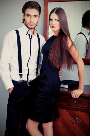 Portrait of a handsome fashionable man with  charming woman posing in the interior. Stock Photo - 11340693