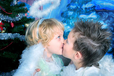 Beautiful little angels over Christmas background. photo