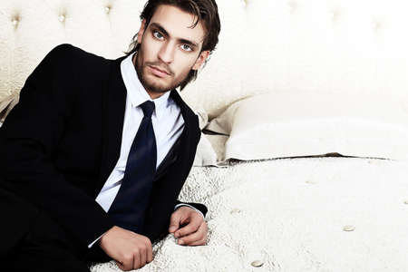 Portrait of a handsome fashionable man posing in the interior. Stock Photo - 11340687