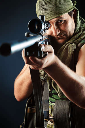 Shot of a conceptual soldier painted in khaki colors. Over black background. Stock Photo - 11340674