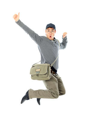 Shot of a happy jumping young man. Isolated over white background. Stock Photo - 11340669
