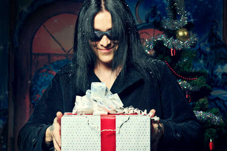 Portrait of a grunge young man with presents. Christmas. Stock Photo - 11340792
