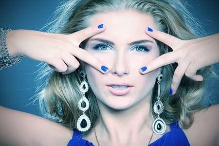 bangle: Portrait of a beautiful woman. Jewelry, make-up.