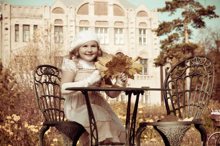 Cute little girl having a rest at a park. Retro style. Stock Photo - 11340771