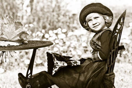 Cute little girl having a rest at a park. Retro style. Stock Photo - 11340769