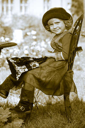 Cute little girl having a rest at a park. Retro style. Stock Photo - 11340768