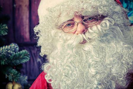 ccloseup: Portrait of Santa Claus over Christmas background. Stock Photo