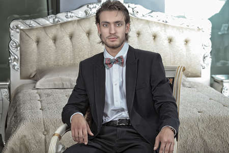 Portrait of a handsome fashionable man posing in the interior. Stock Photo - 11340511