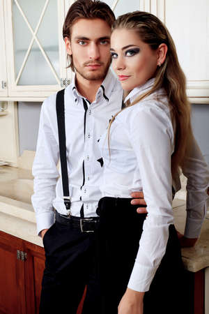 Portrait of a handsome fashionable man with  charming woman posing in the interior. Stock Photo - 11340450