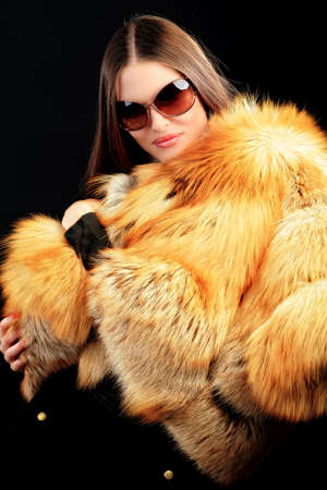 Portrait of a beautiful young woman in a fur. Stock Photo