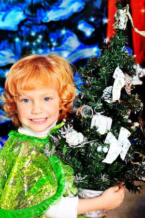 Happy little girl posing in Christmas dress. Stock Photo - 11420092