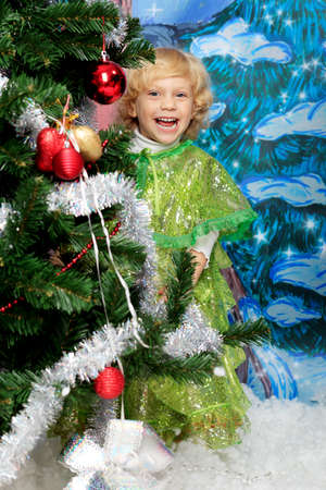 Happy little girl posing in Christmas dress. Stock Photo - 11421484