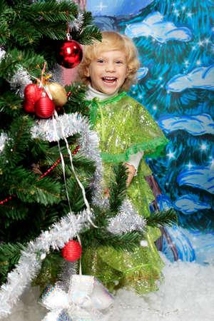 Happy little girl posing in Christmas dress. Stock Photo - 11421484