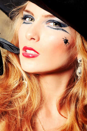 sorcery: Charming halloween witch over vintage background.