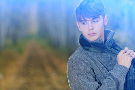 pullover: Handsome young man posing outdoor.