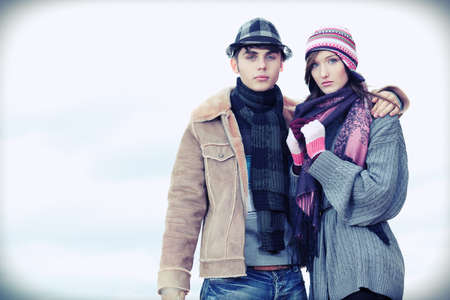 Portrait of a happy young couple in warm clothes outdoor. Stock Photo - 11421555
