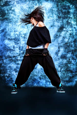 breakdance: Modern teenage girl dancing hip-hop at studio.