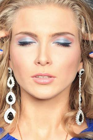 Portrait of a beautiful woman. Jewelry, make-up. photo