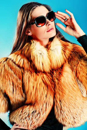 Portrait of a beautiful young woman in a fur. Stock Photo - 11639179