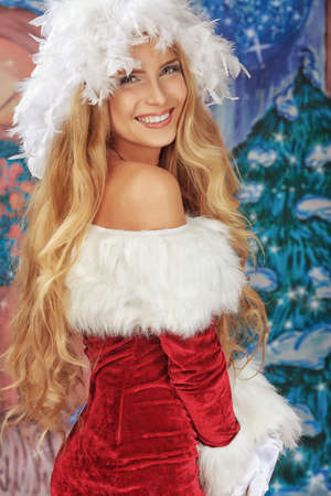 sexy santa girl: Beautiful young woman in Santa Claus clothes over Christmas background.
