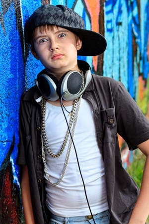 Portrait of a trendy boy teenager with headphones outdoors. Stock Photo - 11639238