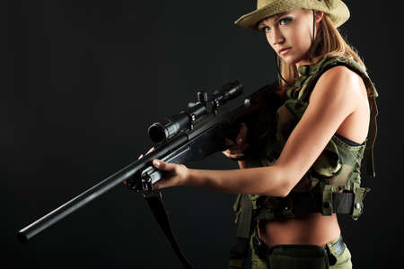Shot of a sexy woman soldier posing against black background. Stock Photo - 11639241