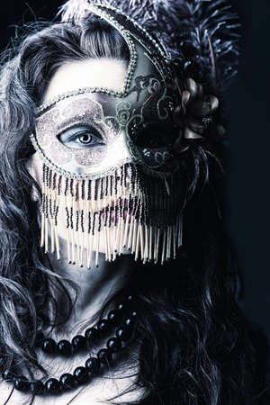 anonym: Portrait of an attractive  woman in mask posing at studio.