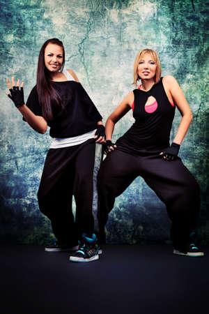 Modern teenage girls dancing hip-hop at studio. Stock Photo