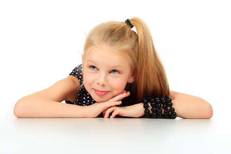 Portrait of a cute 7 years old girl. Isolated over white background. Stock Photo - 11691055