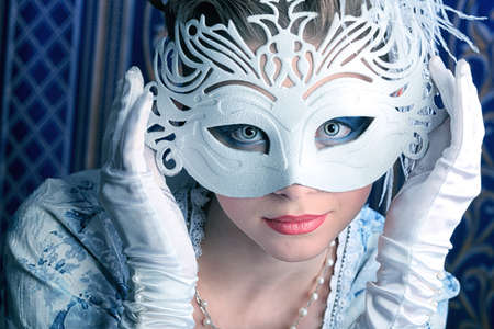 mystery woman: Art portrait of a beautiful female model in a snowy mask. Christmas.