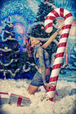 An attractive young woman in celebrating Christmas. photo