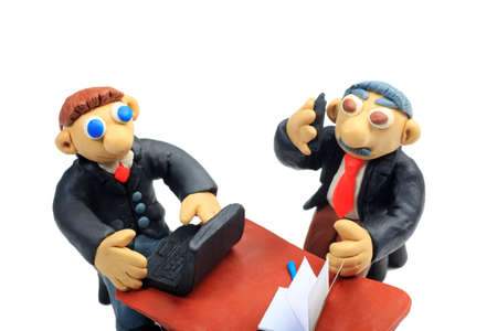 Shot of two plasticine businessmen working at the office. Isolated over white background. photo