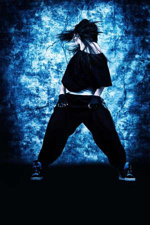 hip hop style: Modern teenage girl dancing hip-hop at studio.