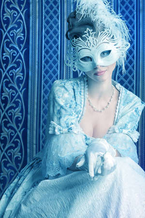 Art portrait of a beautiful female model in a snowy mask. Christmas. photo