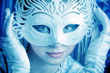 Art portrait of a beautiful female model in a snowy mask. Christmas. Stock Photo - 11800395