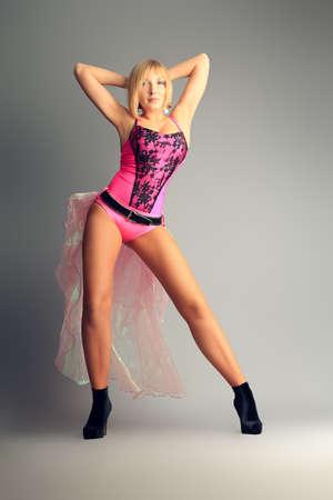flexibility: Modern ballet woman dancer posing at studio.