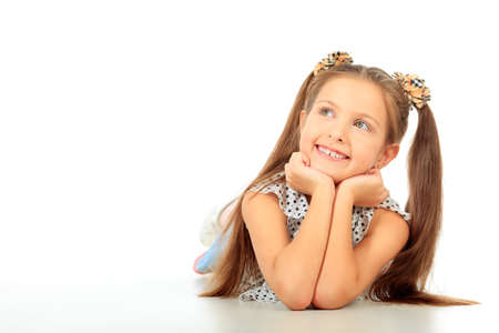pediatrics: Portrait of a cute 7 years old girl. Isolated over white background.