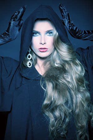 Charming halloween witch over black background. Stock Photo - 11885395