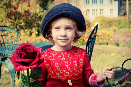 Cute little girl having a rest at a park. Retro style. Stock Photo - 11917784