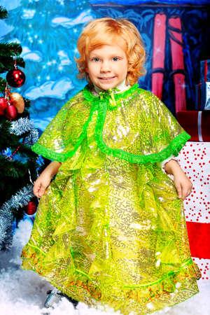 Happy little girl posing in Christmas dress. Stock Photo - 11977388