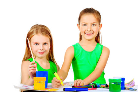 Portrait of two cute girls enjoying painting  Education  Isolated over white background  photo