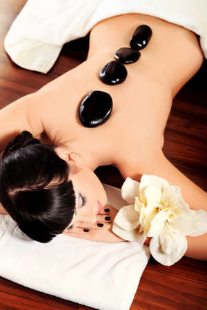 volcanic stones: Beautiful woman relaxing in a spa salon