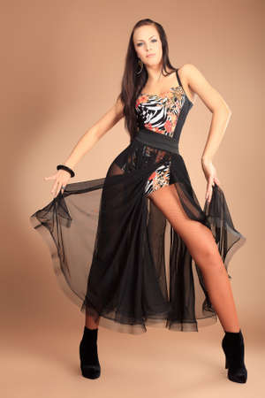 Modern ballet dancer posing at studio.   photo