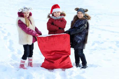 Happy children having fun outdoor on winter.  photo