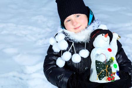Cute girl at a winter park.  photo