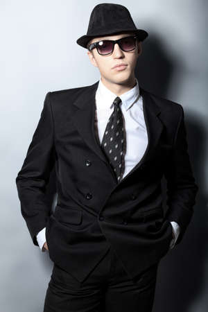 Portrait of a handsome young man in a suit. Shot in a studio. photo